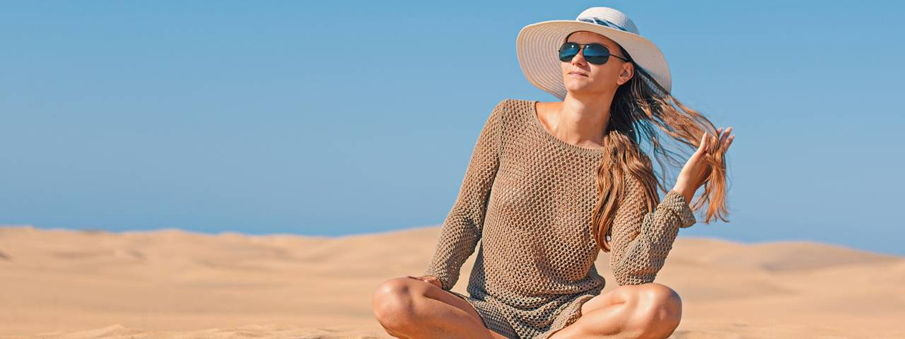 Woman Sunglasses Hat Sitting Beach 1280x480